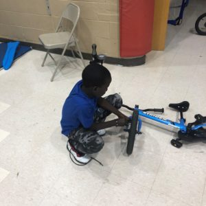 Student helping with bike