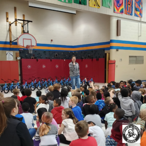 Gretchen Johnson in Front of Students in Gym