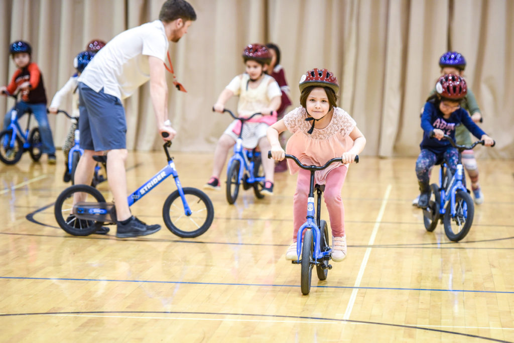 Kids on Bikes in Elementary School Gym