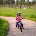 girl in pink on Strider Bike