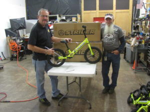 National Museum Hall of Fame Employees Building Bikes for Strawberry Hill